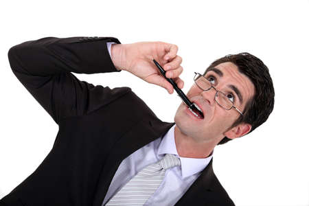 puzzling: Businessman chewing his pen
