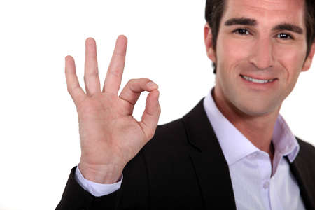 non verbal communication: Man giving the a-ok hand gesture