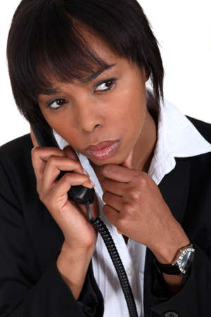 cagey: Serious businesswoman with a phone Stock Photo