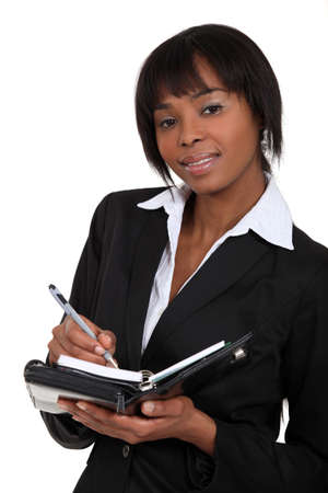 An African American businesswoman with a planner  photo