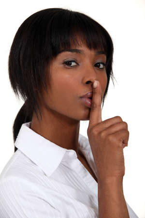 Woman making shush gesture photo