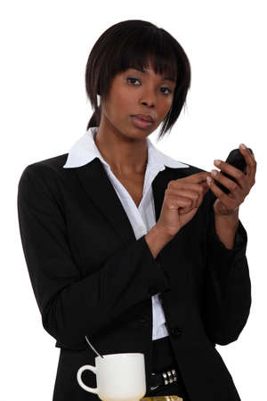 Woman typing a messaging on her touch pad photo