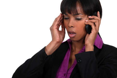 dullness: Office worker receiving bad news over the telephone