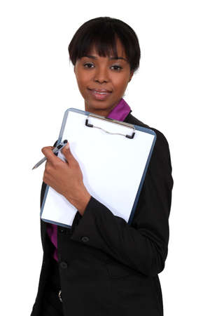 Woman holding a clipboard photo