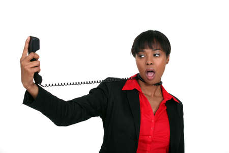 Afro-American businesswoman trying to hang herself with the phone cable photo