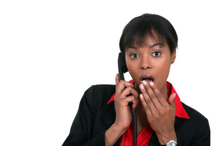 contracted: Surprised woman on the phone Stock Photo