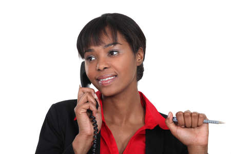 Businesswoman making a call to customer photo