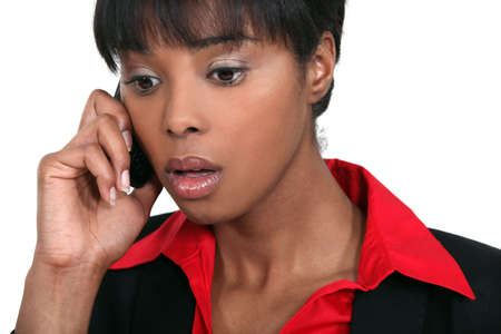 A black businesswoman getting bad news on the phone  photo