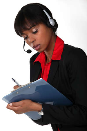 Call-center worker with clipboard photo