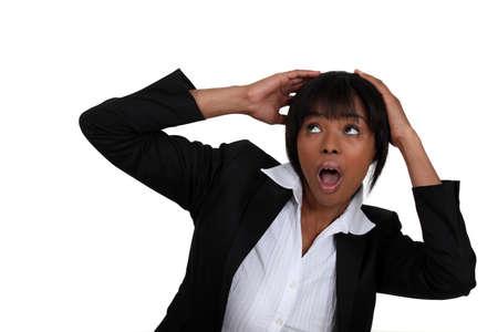 Scared businesswoman shielding her head photo