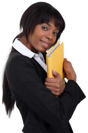 file clerk: File clerk hugging a folder