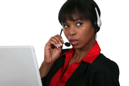 customer service phone: Afro-American businesswoman with headset on her head