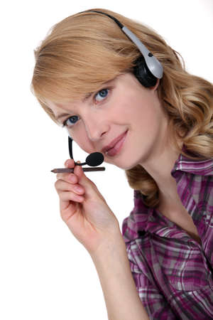 Receptionist wearing telephone head-set photo