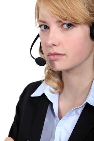 resent: Bitter woman wearing a headset