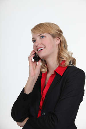 Businesswoman using a cell phone photo