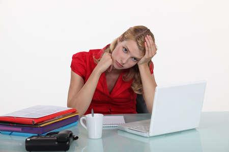 apathy: Woman bored at work