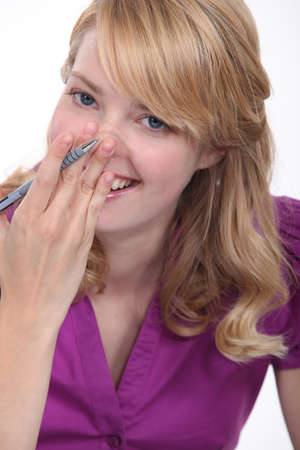 stifle: Woman giggling Stock Photo