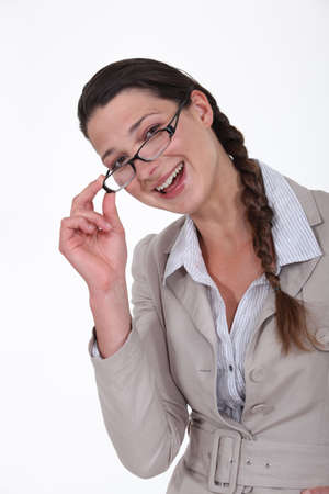 near sighted: portrait of businesswoman looking happy