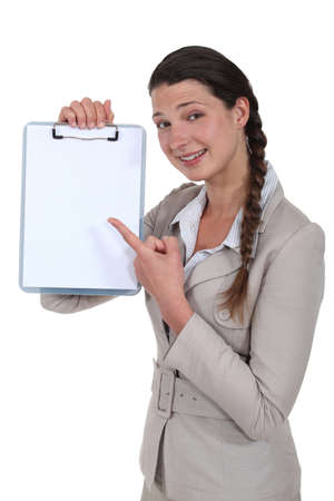 Businesswoman with a blank clipboard photo