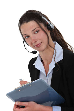 Woman with a headset and a clipboard photo