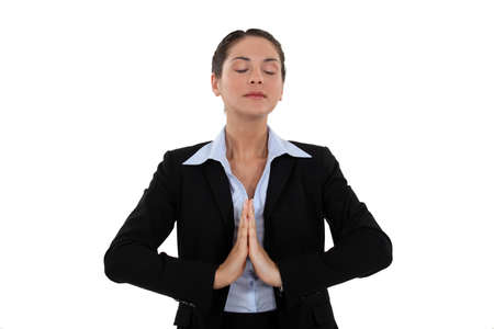 persona respirando: Una mujer de negocios orando