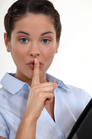 Businesswoman with her finger to her lips Stock Photo - 15290089