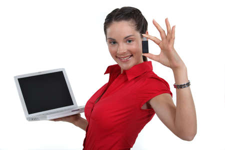pocket pc: Woman holding laptop and USB drive