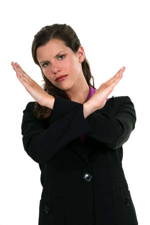 portrait of pretty businesswoman making stop gesture with hands photo