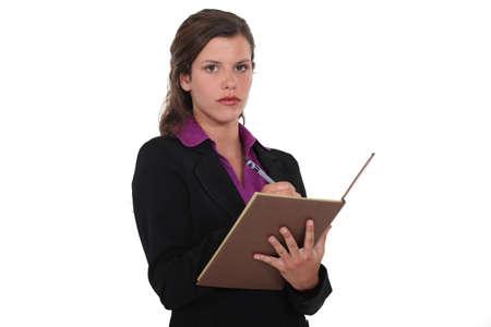 An female executive taking notes  photo