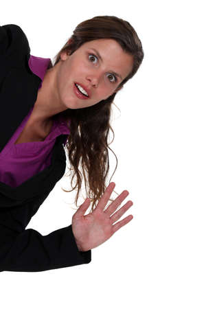 Shocked businesswoman waving hand photo
