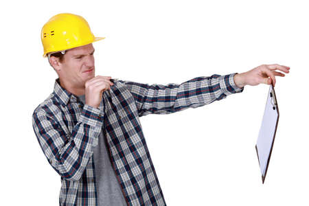cagey: Construction worker holding a distasteful clipboard