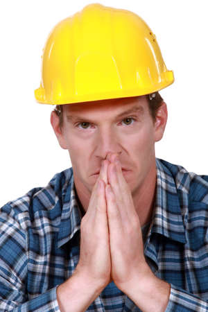 omission: Construction worker praying