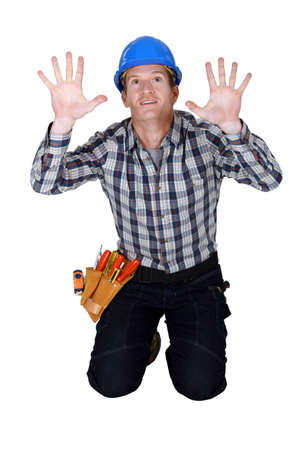 tradesperson: Tradesman pressing his hands against a see-through wall