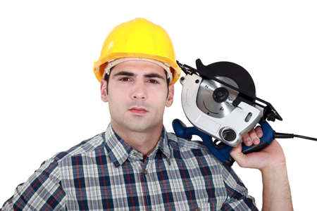 wood cutter: Man posing with electrical saw