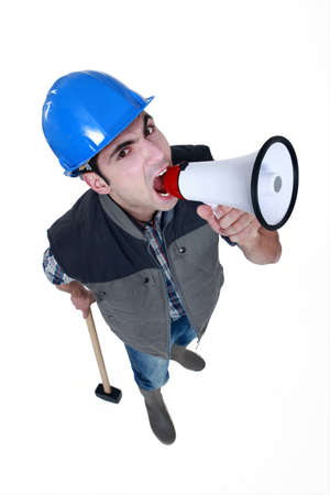 angry craftsman shouting through a megaphone photo