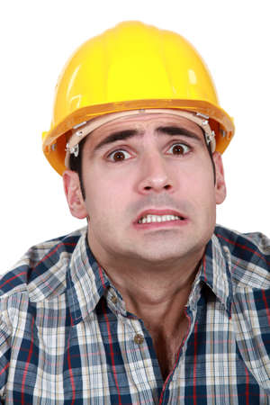 horrified: craftsman looking frightened Stock Photo