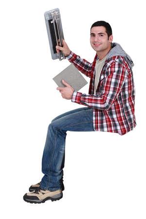 Man using tile cutting device Stock Photo - 15289921