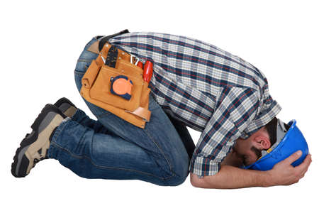 Construction worker curled up on the floor