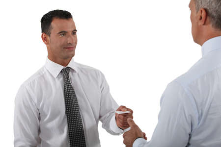 Man handing over his business card to a potential client photo