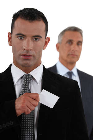 Businessman removing card from pocket Stock Photo - 15289989