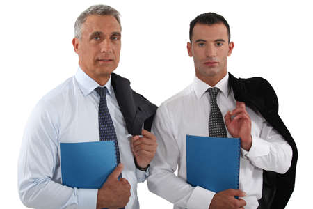 Two businessmen stood with folders photo