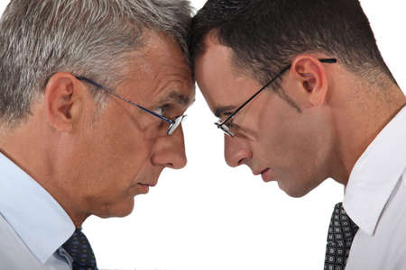 co action: Businessmen head to head Stock Photo
