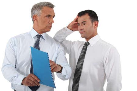 reprimanding: Boss reprimanding his employee