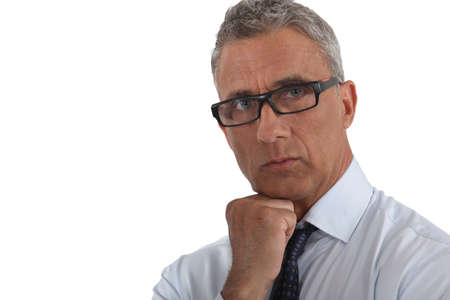 greying: Portrait of a man wearing thick-rimmed glasses Stock Photo