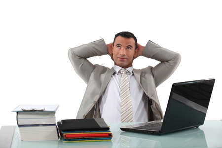 Office worker stretching at his desk Stock Photo - 15289952