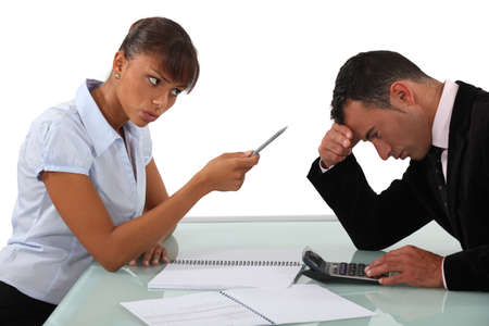 business disagreement: businessman and female colleague in disagreement Stock Photo