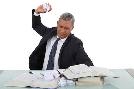 throw paper: A frustrated businessman Stock Photo