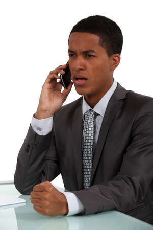 Businessman getting angry during call photo
