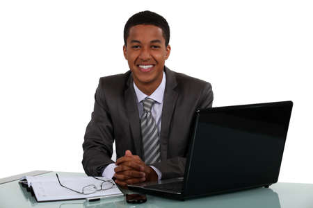 peppy: Portrait of a smiling young businessman
