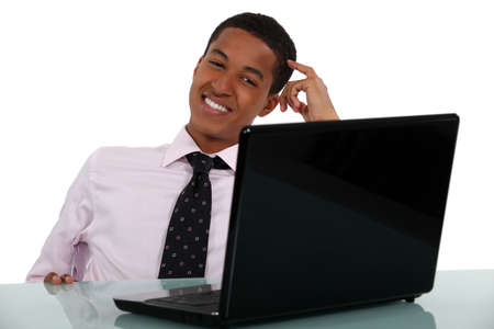 Happy young businessman scratching head Stock Photo - 15289830
